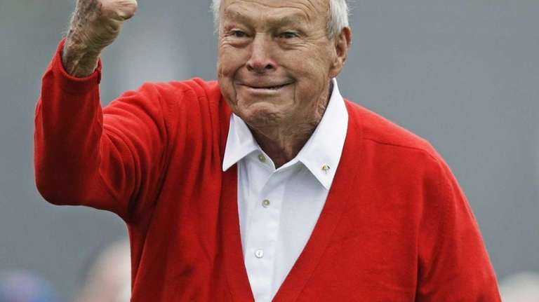Honorary starter Arnold Palmer punches the air after
