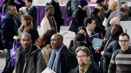 Job seekers attends a health-care job fair this