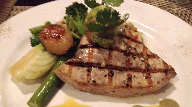 Grilled swordfish with avocado relish and citrus vinaigrette