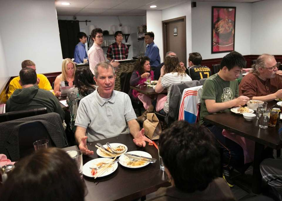 Eugene Wood of Wantagh dines with friends at