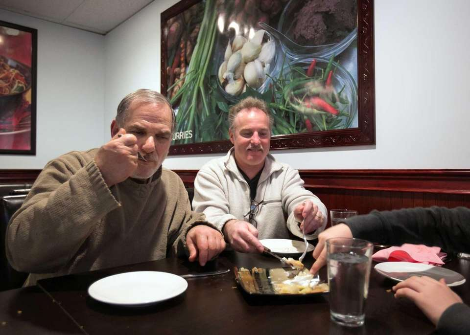 Mike Jacobs and Pete Muller share dessert at