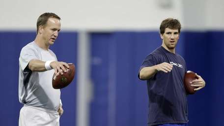 Denver Broncos quarterback Peyton Manning, left, and brother