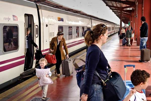 Passengers arrive from Paris at the Chamartin train