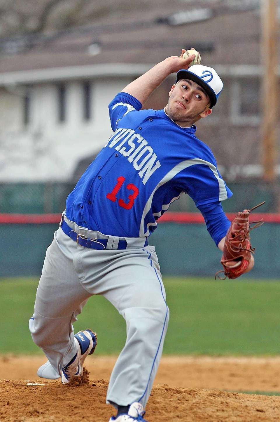 Division's Anthony Papa pitches against Clarke. (April 11,