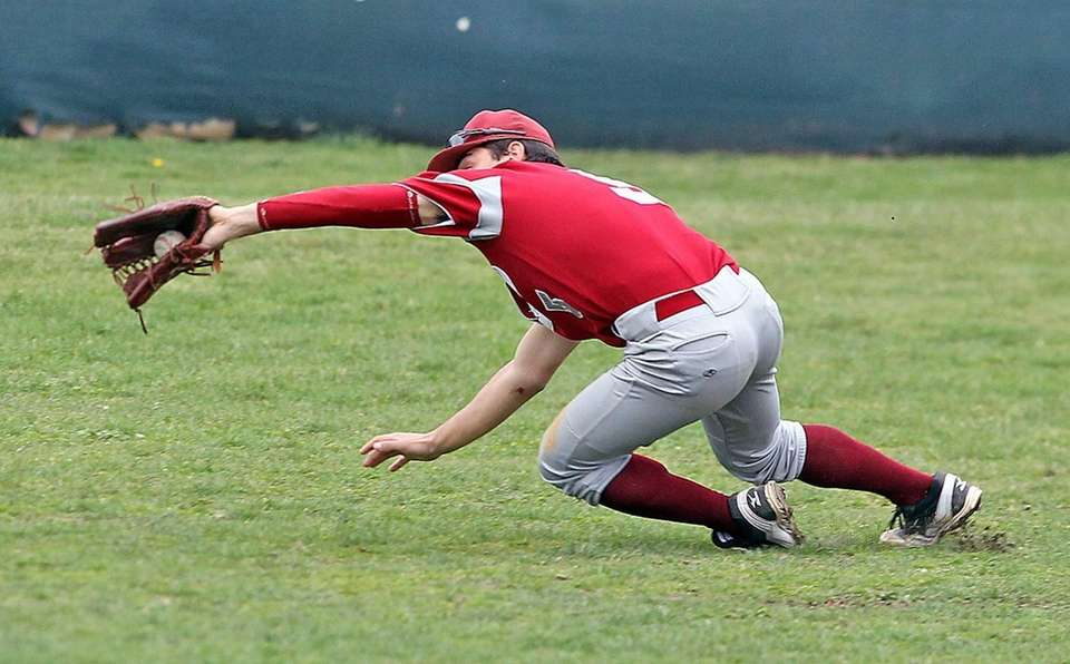 Clarke's Joe Fusco makes a diving catch for
