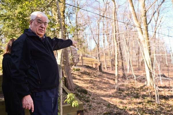 Joe Berardino shows the damage to his property