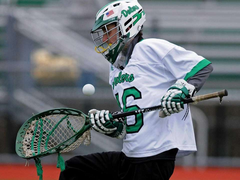 Farmingdale goalie Scott DePalma makes a save during
