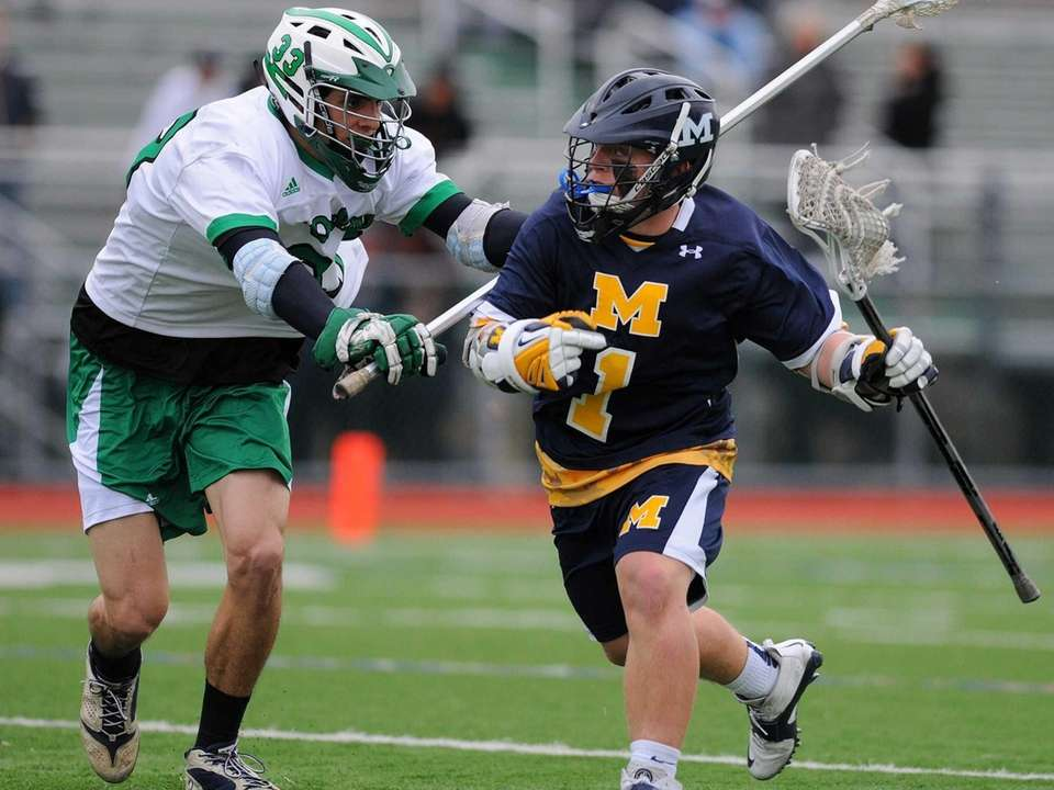 Massapequa's Jim Byrns, right, gets pressured by Farmingdale's