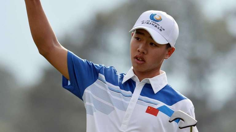 Tianlang Guan of China reacts during the first