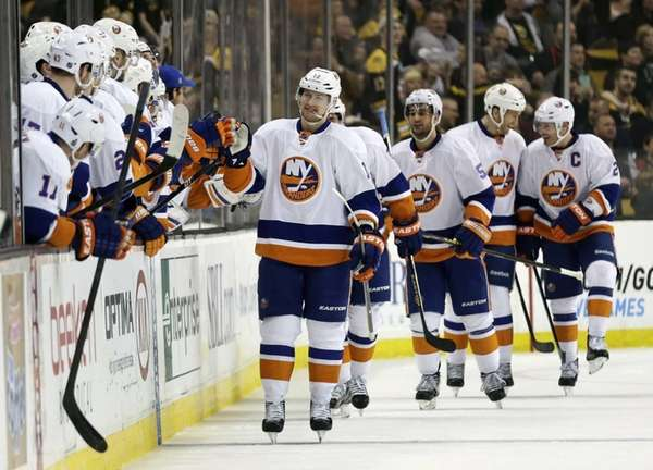 Islanders center Josh Bailey, center, is congratulated by