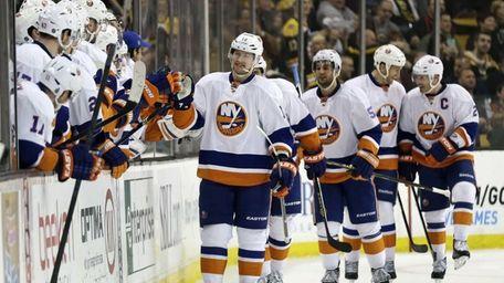 Islanders center Josh Bailey, center, is congratulated by
