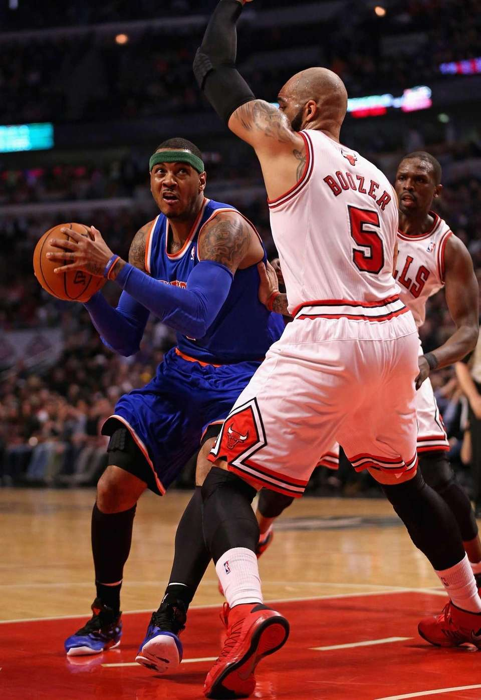 Carmelo Anthony of the Knicks drives against Carlos