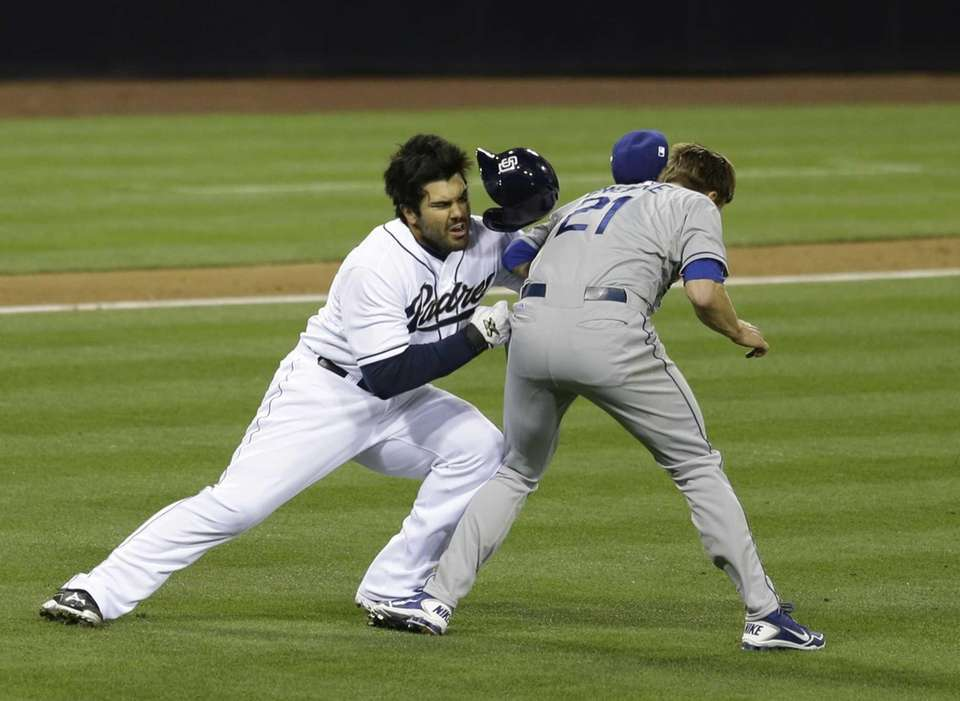 San Diego Padres' Carlos Quentin charges into Los