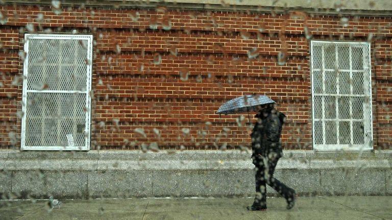 Pedestrians walk along Park Avenue in Long Beach