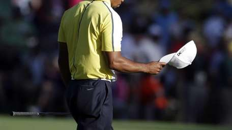 Tiger Woods reacts after his fairway shot on