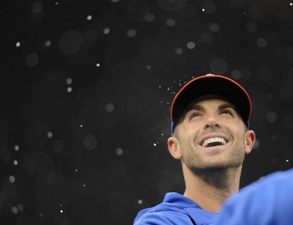 David Wright of the Mets reacts as snow