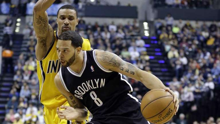 Nets guard Deron Williams, front, drives past Indiana