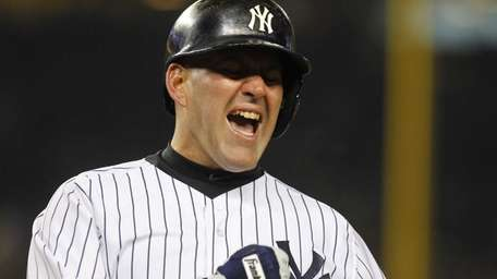 Kevin Youkilis of the Yankees reacts after being