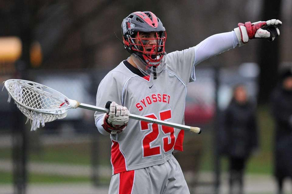 Syosset goalie Ryan Feit communicates with his teammates