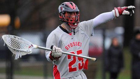 Syosset goalie Ryan Feit communicates with his teammates