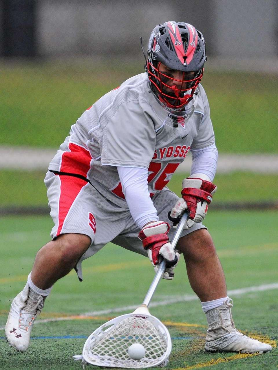 Syosset goalie Ryan Feit secures a ball after