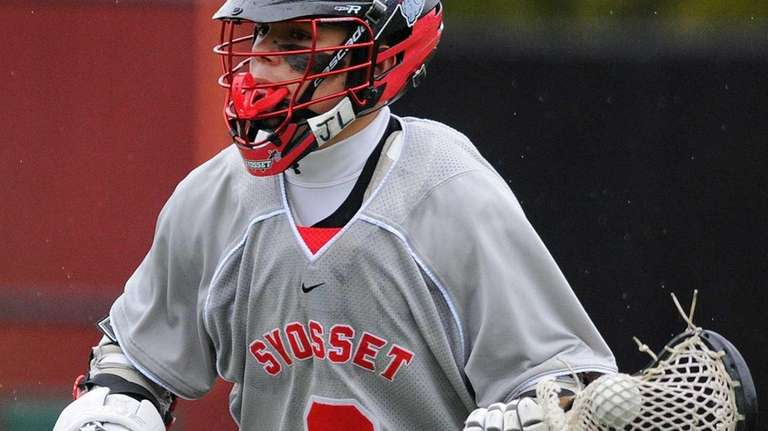 Syosset sophomore Alex Concannon circles behind the net