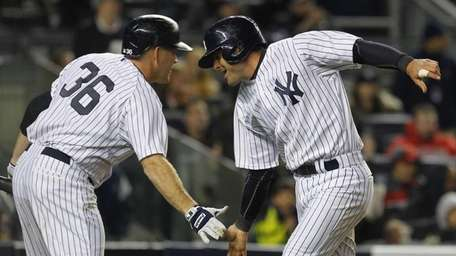 Francisco Cervelli of the Yankees is greeted by