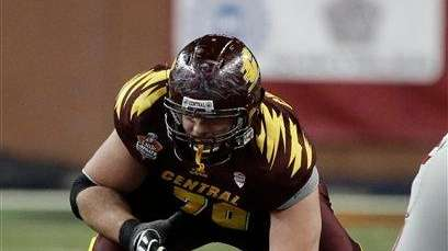 Central Michigan offensive linesman Eric Fisher waits for