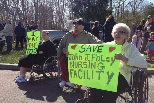 People gather at the Foley nursing home to
