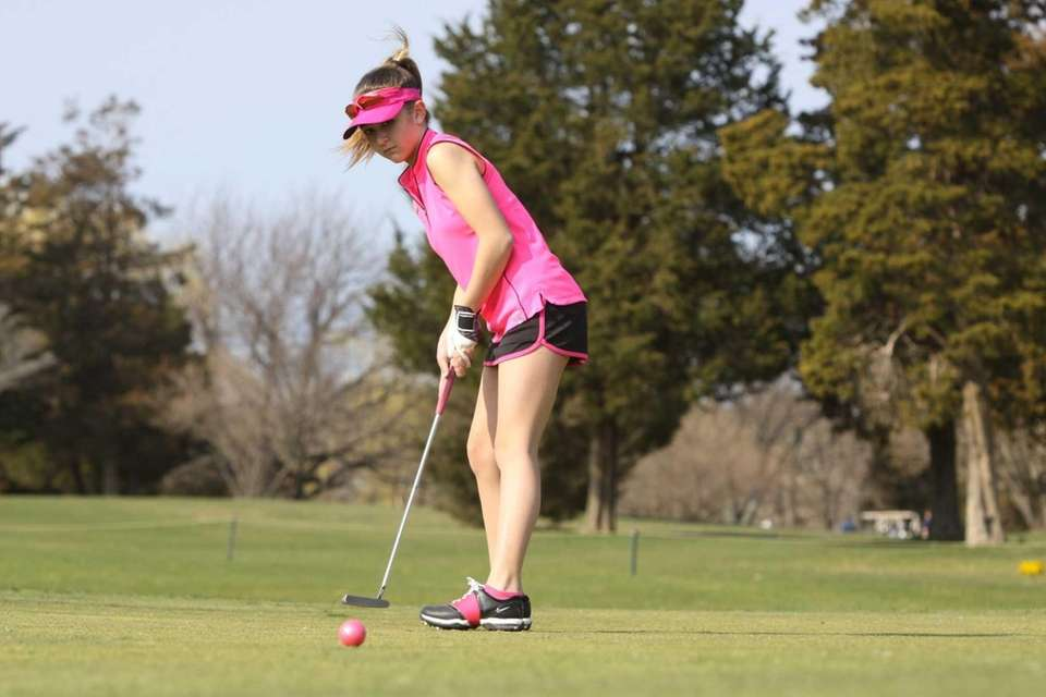 Deanna Confessore of Greenlawn, 12, putts as she