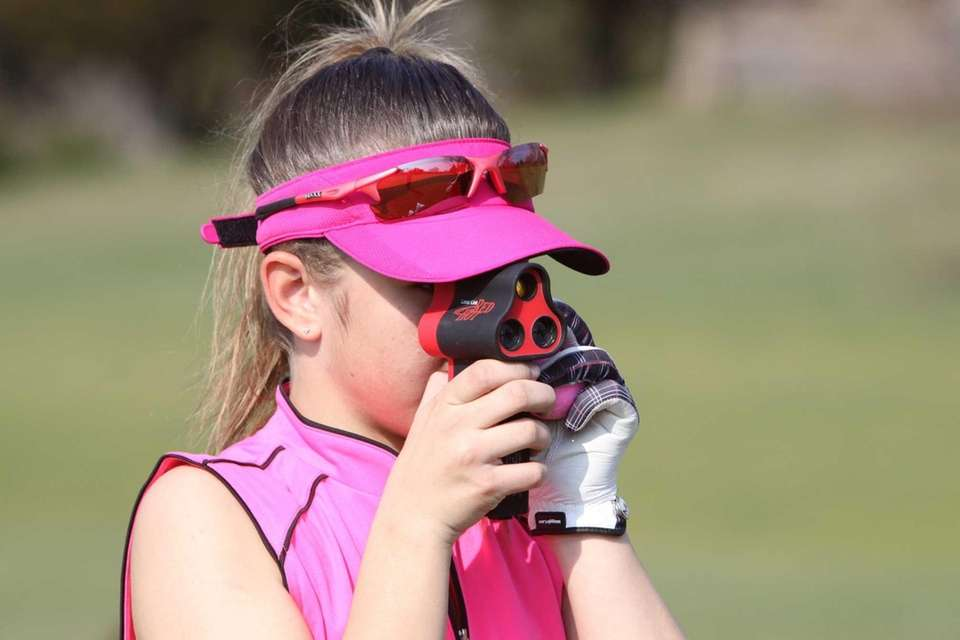 Deanna Confessore of Greenlawn, 12, uses a rangefinder