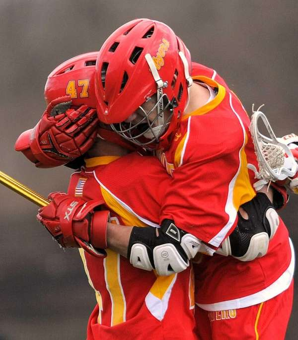 Chaminade's Vincent Connors, right, gets a congratulatory hug