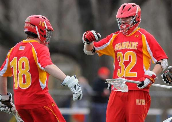 Chaminade's Joseph Stone, right, and goalie Daniel Fowler