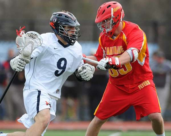 Manhasset's Michael Fahey, left, gets pressured by Chaminade's