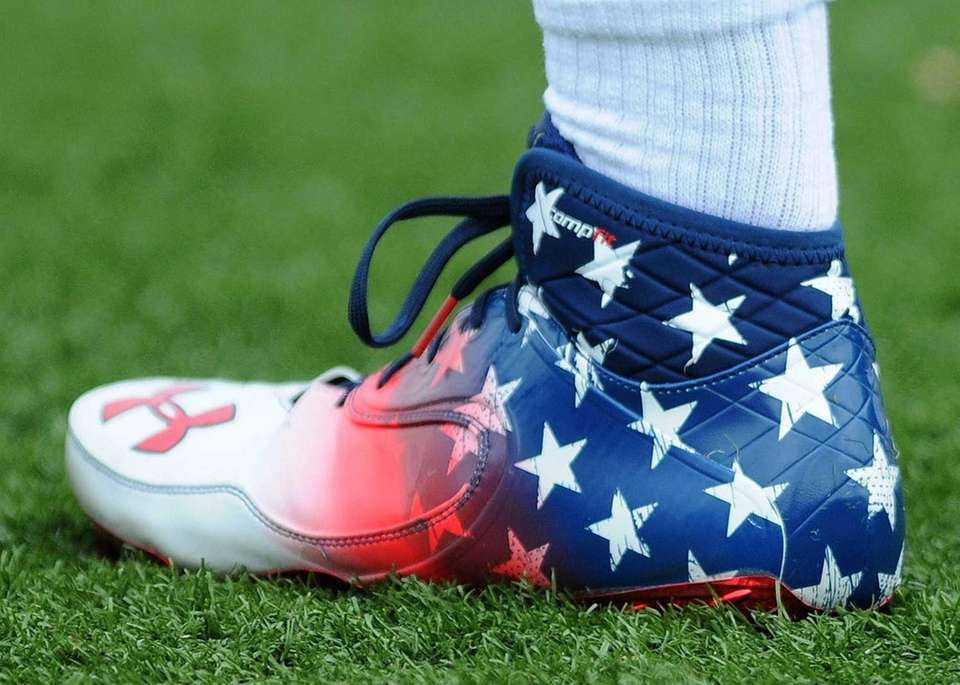 Chaminade's John McDaid sports patriotic footwear during a