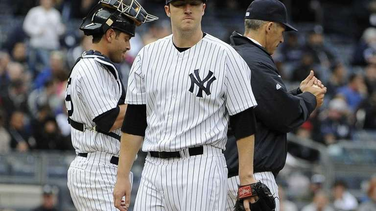 Phil Hughes of the Yankees reacts as he