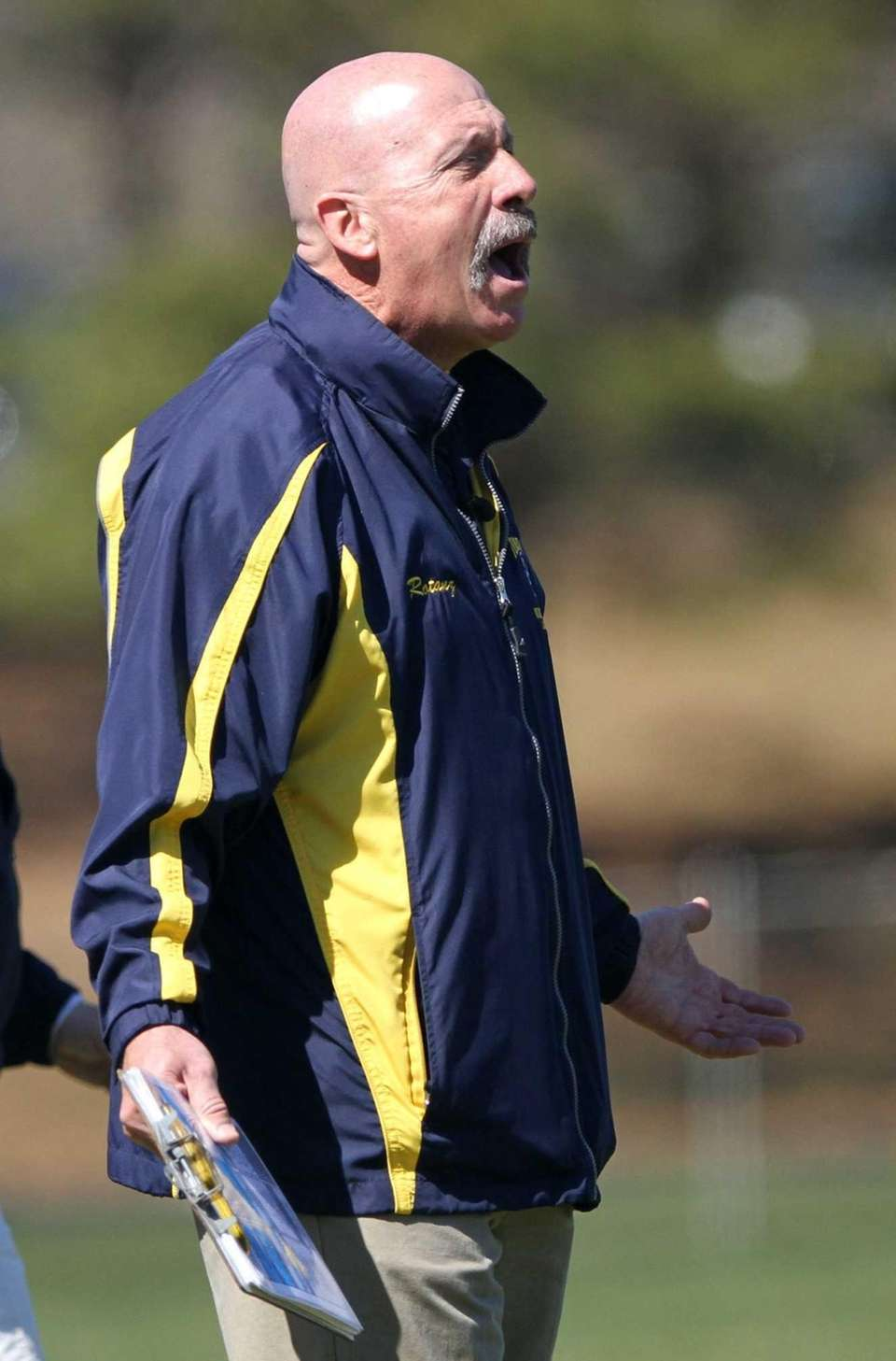 Shoreham-Wading River coach Tom Rotanz reacts to an