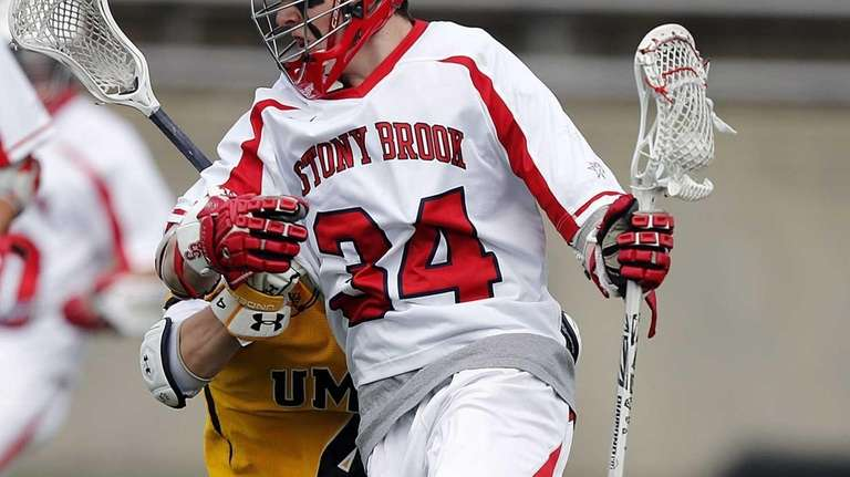 Stony Brook Seawolves' Chris Hughes drives into the