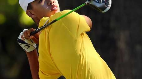 Tianlang Guan hits a tee shot on the