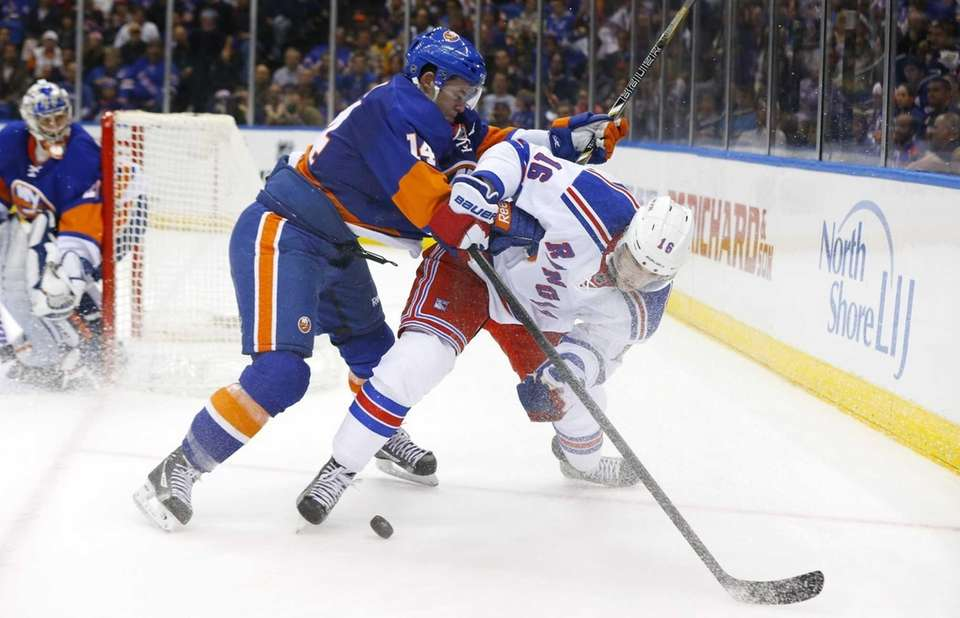 Thomas Hickey of the Islanders defends in the