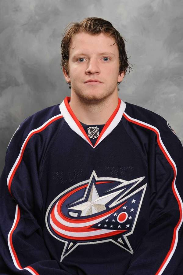 Derek Dorsett poses for his official headshot for