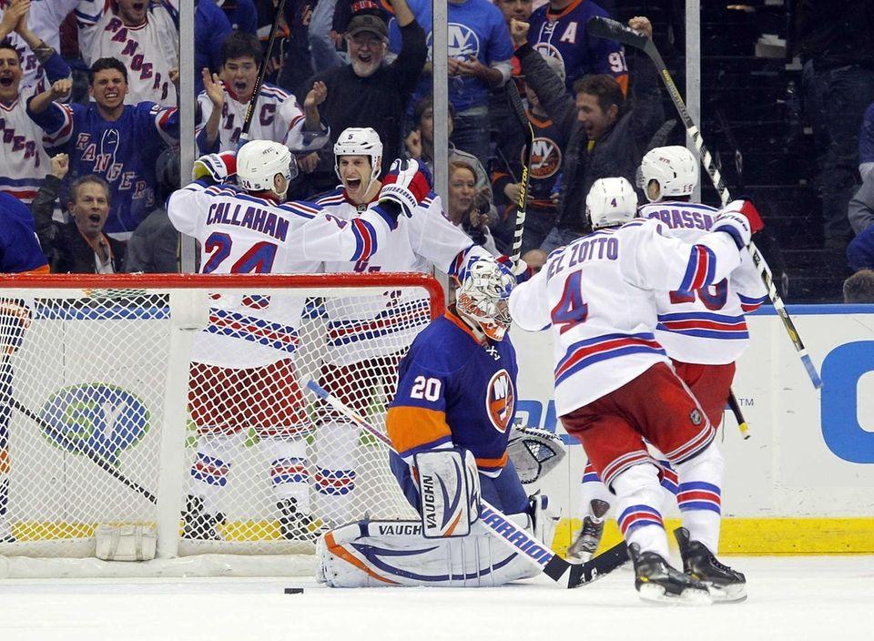 Dan Girardi of the Rangers celebrates his overtime