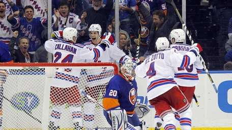 Dan Girardi of the Rangers celebrates his overtime