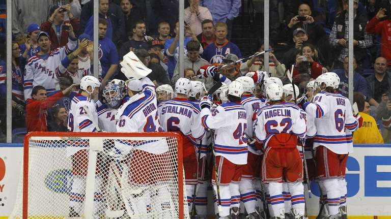 The Rangers celebrate their overtime victory against the