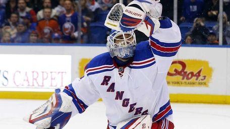 Henrik Lundqvist of the Rangers makes a glove