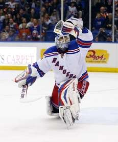 Henrik Lundqvist of the Rangers makes a glove