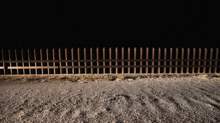 A section of the U.S.-Mexico border fence stands