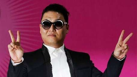 South Korean rapper PSY poses during a news