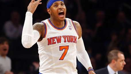 Carmelo Anthony reacts after a basket during a