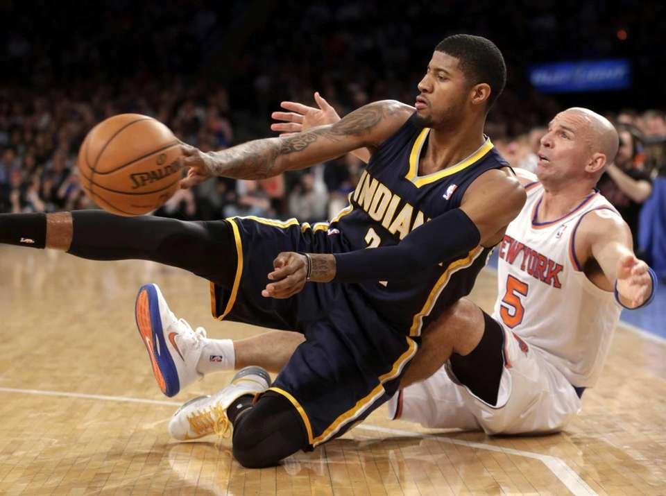 The Indiana Pacers' Paul George, left, passes the